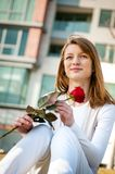 Gift - young woman with red rose Stock Photos