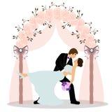Gifta sig bågen med bruden och brudgummen Arkivbilder
