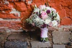 Gifta sig blommabrudbuketten Fotografering för Bildbyråer
