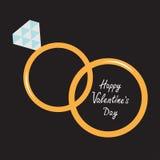 Gifta sig guld- cirklar. Lyckligt valentindagkort. Arkivfoto