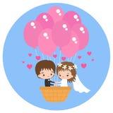 Gifta sig i en ballong för varm luft i formen av en hjärta Arkivfoton