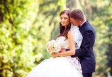 Gifta sig skottet av bruden och brudgummen arkivbild