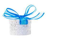 Giftbox. White decorative giftbox with big blue ribbon Royalty Free Stock Photo