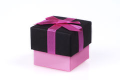 Giftbox. With pink bow on white backround stock image