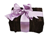 Giftbox. A present wrapped with soft brown material and a satin bow on white with clipping path Stock Image
