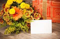 Giftbox And A Bouquet Of Flowers Royalty Free Stock Images