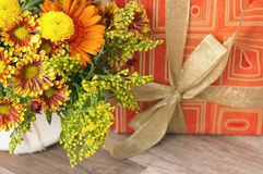 Giftbox and a bouquet of flowers Royalty Free Stock Photos