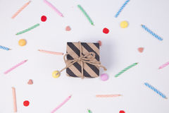 Giftbox with candlesand candy for birthday on pink background. Stock Photo