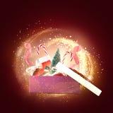 Giftbox con los objetos de la Navidad Imagen de archivo libre de regalías
