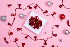 Giftbox with decoration accessories on pink background stock image
