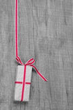 Giftbox with red striped ribbon for Christmas or birthday Royalty Free Stock Photography