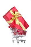Giftbox and shopping cart Royalty Free Stock Photo