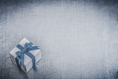 Giftbox with tied blue bow on metallic background holidays conce Royalty Free Stock Photography