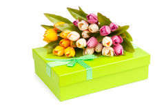 Giftbox and tulips Stock Photos