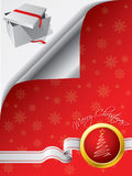 Giftbox under folded red greeting Stock Photography