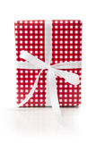 Giftbox wrapped in checkered paper - country style Royalty Free Stock Images