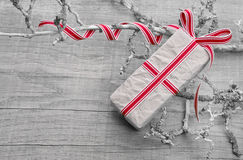 Giftbox wrapped in paper on a wooden background in shabby style Stock Photo