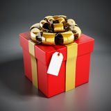 Giftbox. Wrapped with red ribbon  on black Stock Photography