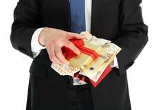 Giftbox z pieniądze zdjęcia stock