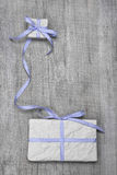 Giftboxes with blue striped ribbon on a wooden background Royalty Free Stock Photos