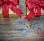 Giftboxes with tied red knots on vintage wood board celebration. Concept royalty free stock photos