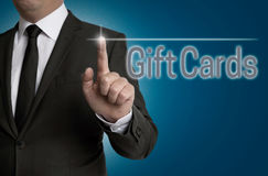 Giftcard touchscreen is operated by businessman Royalty Free Stock Photo