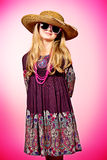Gifted child. Little fashion girl in beautiful dress, beads and sunglasses posing over pink background Stock Images