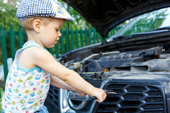 Gifted kid repairing car engine Royalty Free Stock Photo