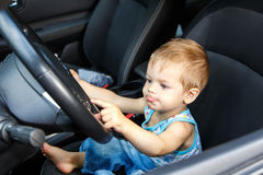 Gifted small kid drives real car Stock Photos