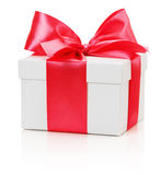 Gifting box with red bow isolated on the white background Royalty Free Stock Photos