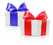 Gifting boxes with red and blue bow isolated on the white backgr Stock Photos