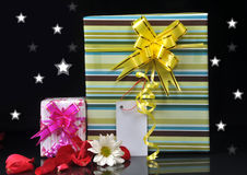 Gifts. Gift box with decorative stars and flowers Royalty Free Stock Photos