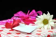 Gifts. Gift box with flowers against black Royalty Free Stock Photography