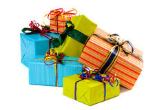 Gifts. X-Mas gifts in red, blue and green paper Royalty Free Stock Photography