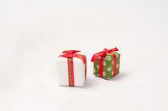 Gifts. Two Christmas gifts isolated on the white stock photo