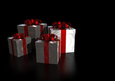 Gifts. Lot of presents  with  a shiny red ribbon isolated on black reflective background Stock Photography