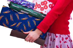 Gifts. A girl holds a lot of gifts Royalty Free Stock Photography