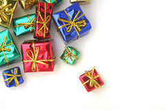 Gifts. Several Gift Boxes wrapped in foil wrapping paper on white background Stock Image