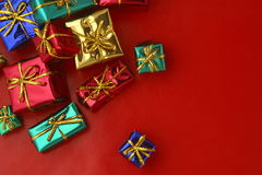 Gifts. Several Gift Boxes wrapped in foil wrapping paper Stock Photography