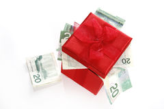 Gifts. Give the gift of money for Christmas stock image