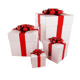 Gifts. Over white wrapped in white paper with red ribbons - 3d render Royalty Free Stock Photos