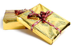 Gifts. Two boxes in golden gift wrapping Stock Photography