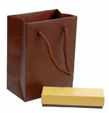 Gifts. Brown shopping bag and a little brown box isolated over white background with clipping path included in the file Stock Photography