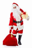 Gifts. Santa Claus with a bag and a gift on a white background Royalty Free Stock Photography