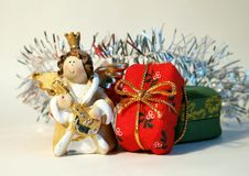 Gifts. An angel and some gifts royalty free stock photography