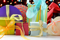 Gifts. On sparkling lights background stock photos