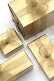 Gifts. Golden gifts Royalty Free Stock Photo