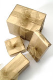 Gifts. Four golden boxes Royalty Free Stock Photography
