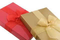 Gifts. Red and gold gift boxes isolated on white Stock Images