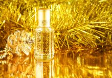Gifts with Arabian perfume on golden background. Holidays decoration. Christmas, Birthday, Valentines Day. Gifts with Arabian perfume on golden background stock photography